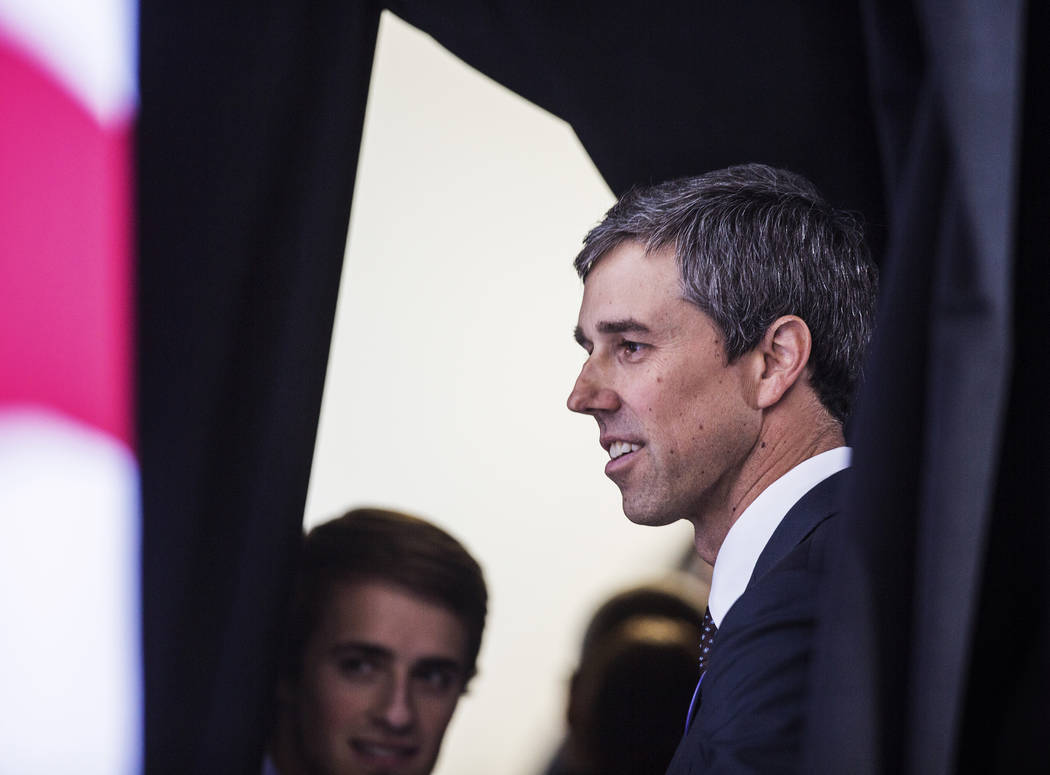 Presidential candidate and former Texas congressman Beto O'Rourke, right, speaks with supporter ...