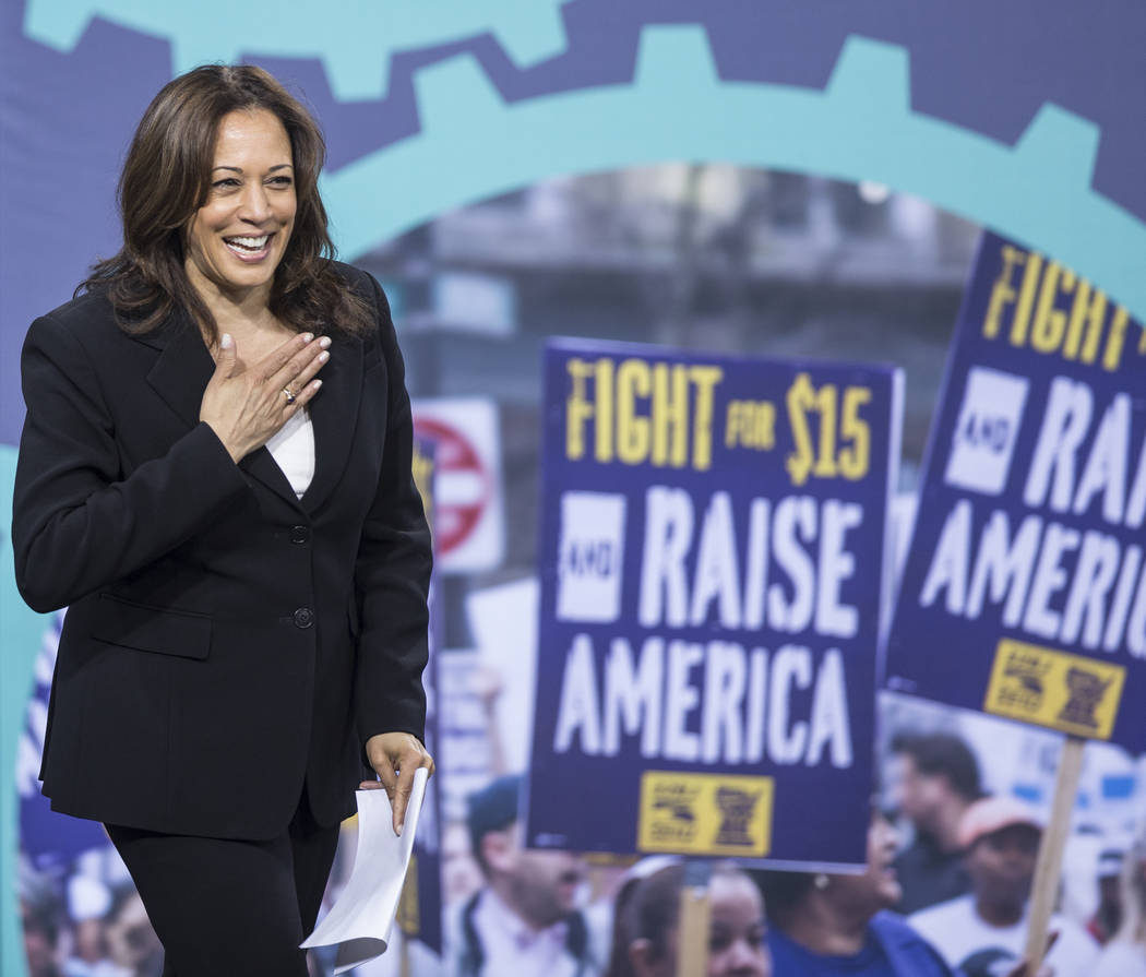 Presidential candidate Sen. Kamala Harris, D-Calif., walks on stage during ÒNational Forum ...