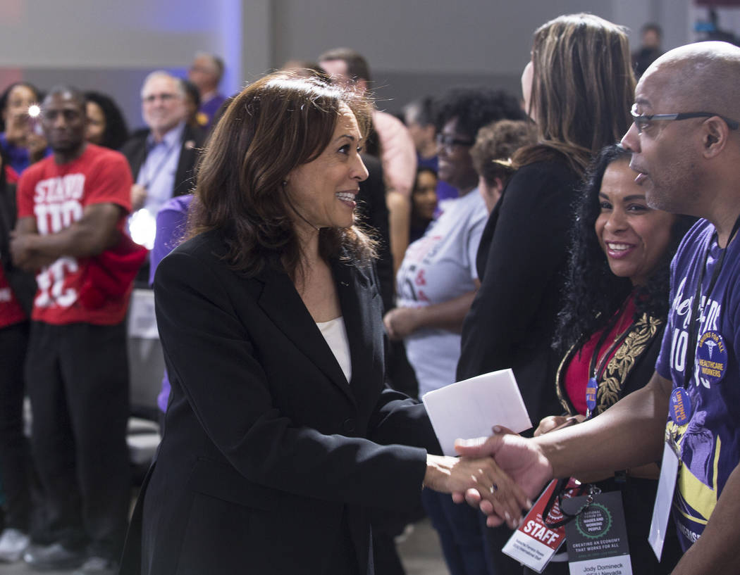 Presidential candidate Sen. Kamala Harris, left, D-Calif., shakes hands with supporters during ...