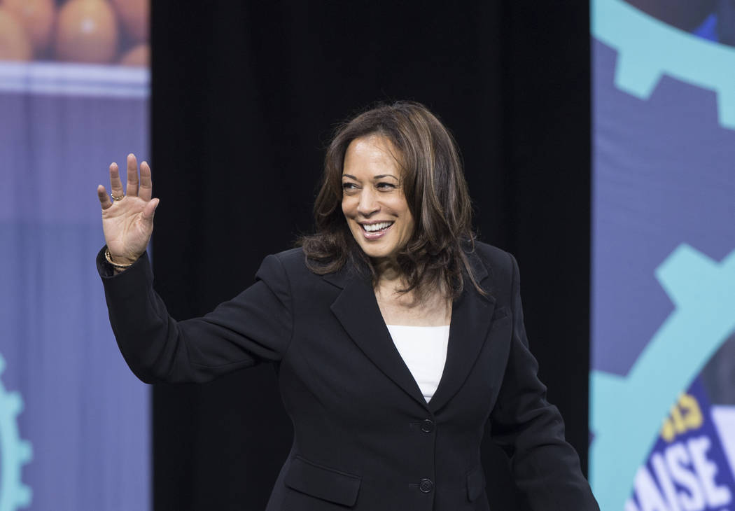 "Presidential candidate Sen. Kamala Harris, D-Calif., walks on stage during ""National For ..."