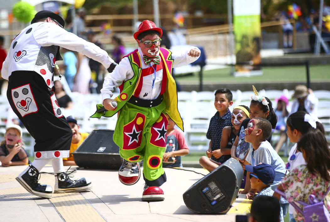 Children watch as Chirolito and Bobofito perform during the 10th annual Dia del Nino event at t ...