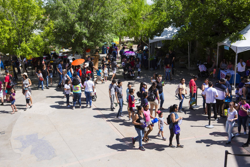 Attendees check out different vendors during the 10th annual Dia del Nino event at the Springs ...