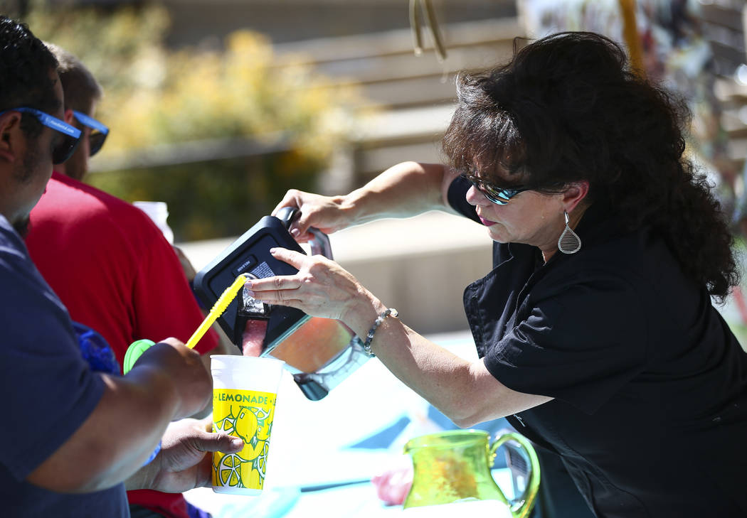 Leticia Mitchell, executive chef of Leticia's Mexican Cocina, pours sorbet for attendees after ...