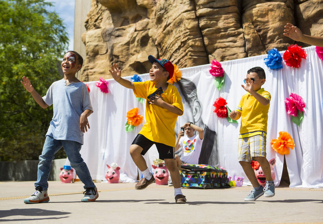 Seven-year-old Cristian Mendoza, center, of Las Vegas, and Christopher Villegas, 5, right, of L ...