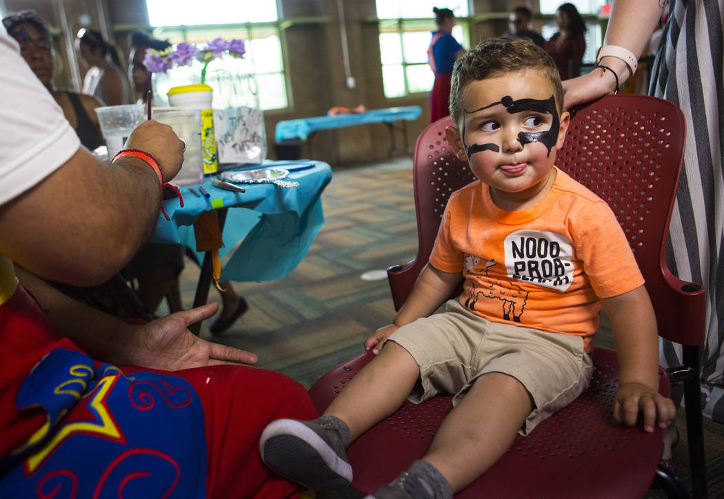 Gabriel Fernandez, 2, looks on while getting his face painted during the 10th annual Dia del Ni ...