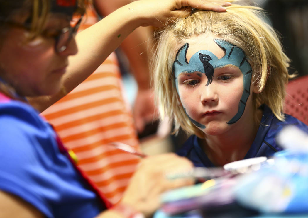 Christian LeMone, 5, of Las Vegas, gets his face painted during the 10th annual Dia del Nino ev ...