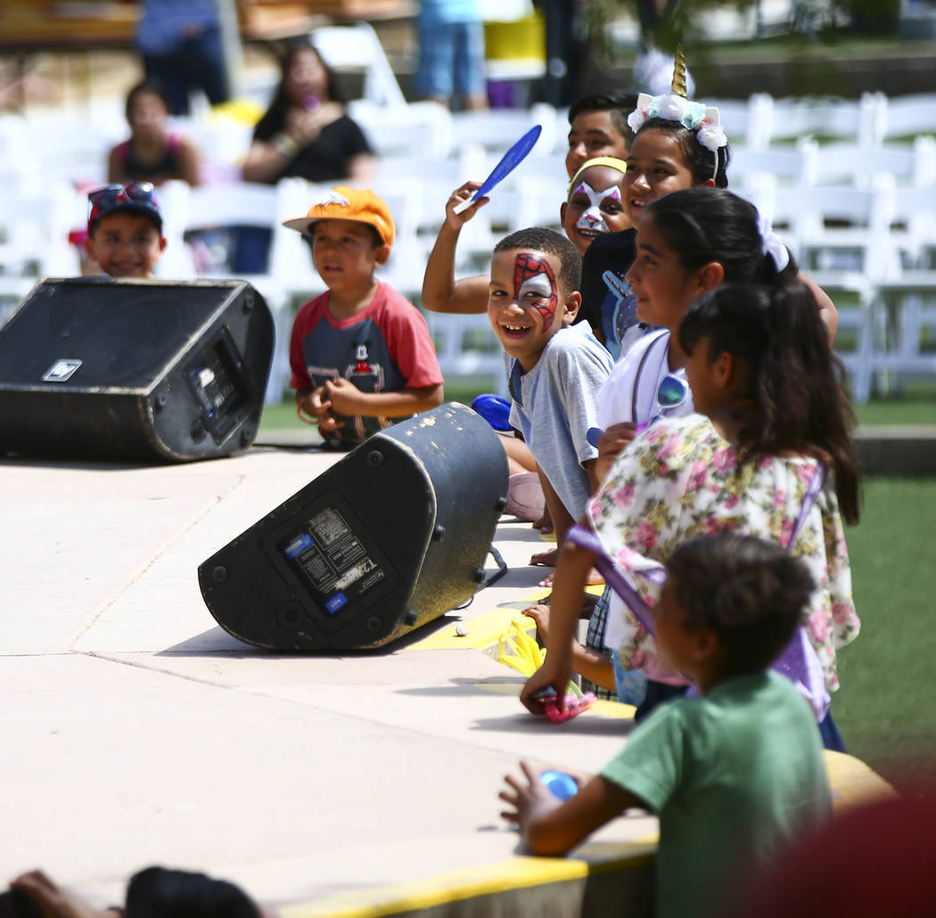 Children watch a clown performance during the 10th annual Dia del Nino event at the Springs Pre ...