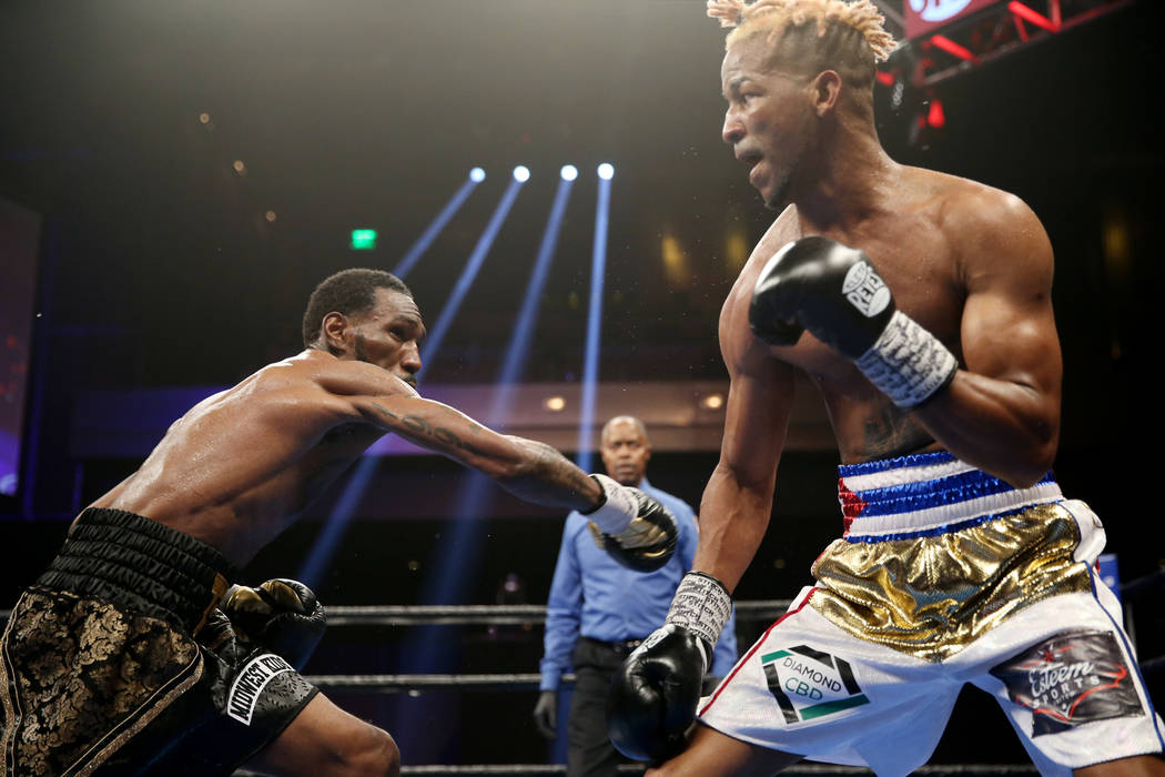 Robert Easter Jr., left, throws a punch against Rances Barthelemy in the WBA lightweight champi ...