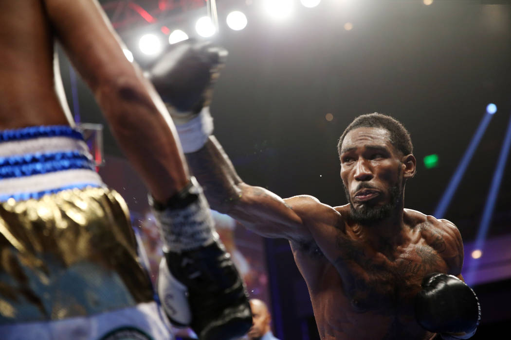 Robert Easter Jr., right, throws a punch against Rances Barthelemy in the WBA lightweight champ ...