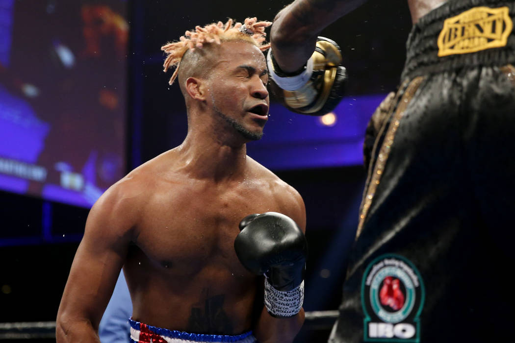 Rances Barthelemy, left, takes a punch from Robert Easter Jr. in the WBA lightweight championsh ...