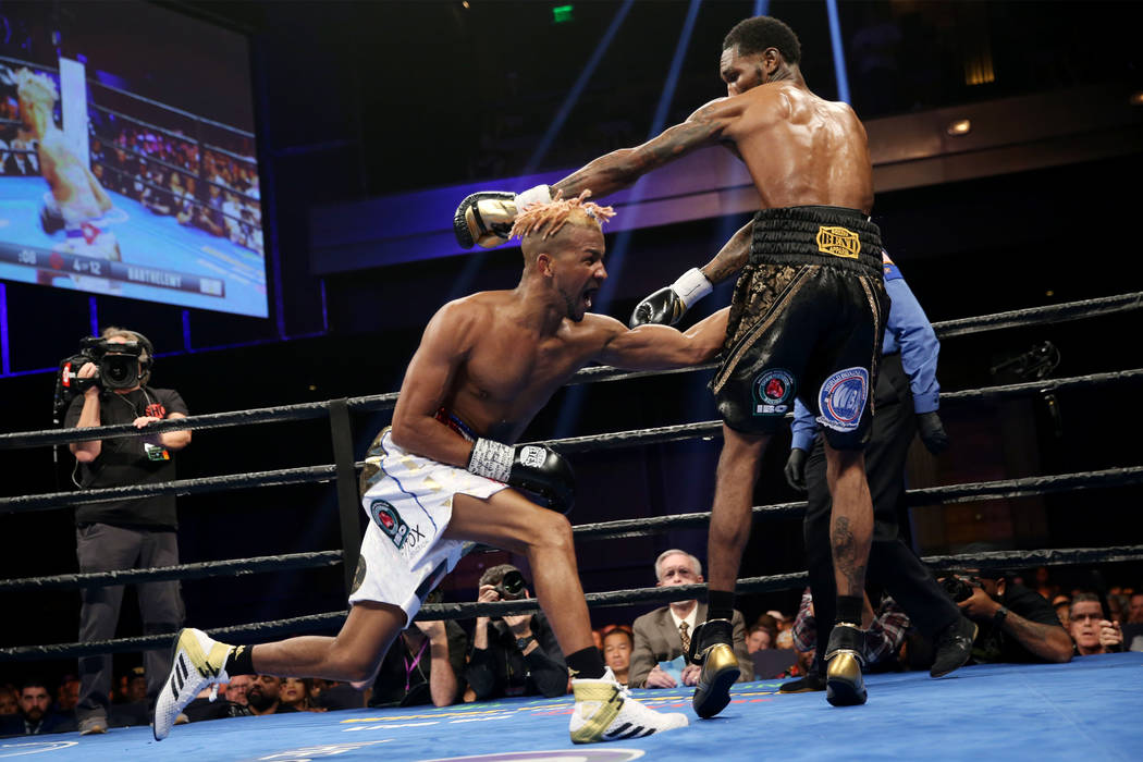 Rances Barthelemy, left, throws a punch against Robert Easter Jr. in the WBA lightweight champi ...