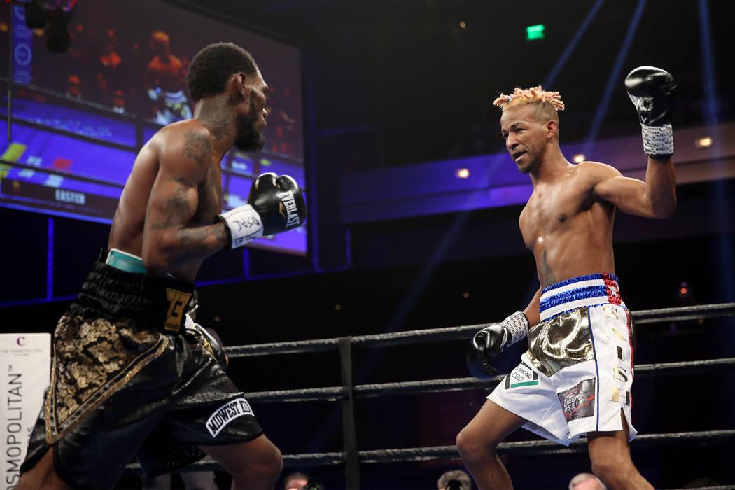 Robert Easter Jr., left, battles Rances Barthelemy in the WBA lightweight championship bout at ...