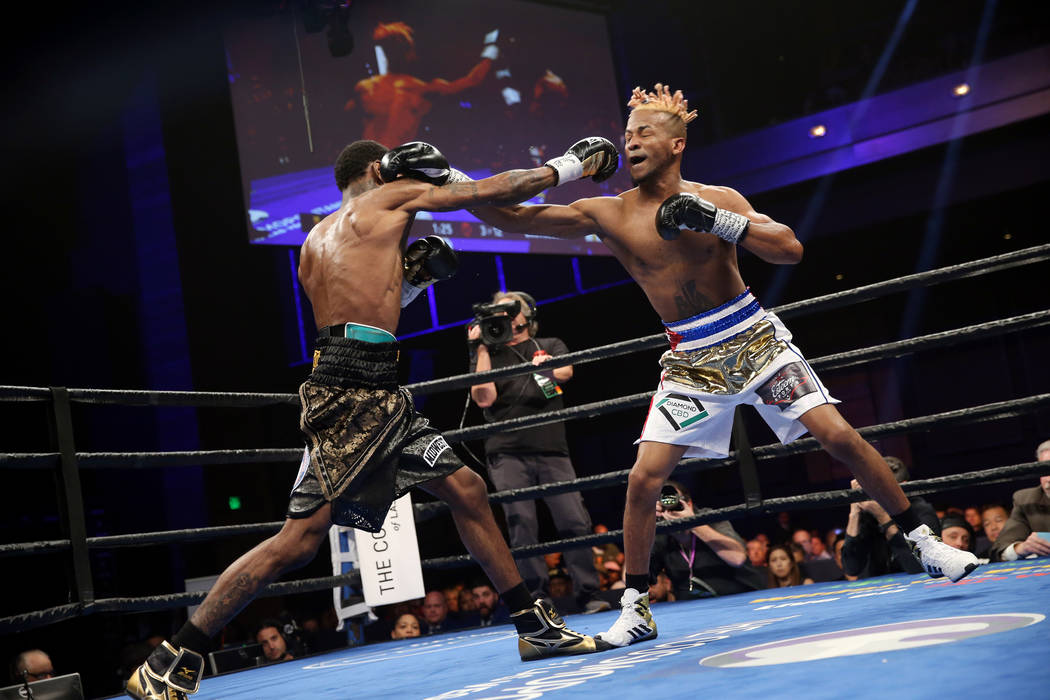 Robert Easter Jr., left, exchanges punches with Rances Barthelemy in the WBA lightweight champi ...
