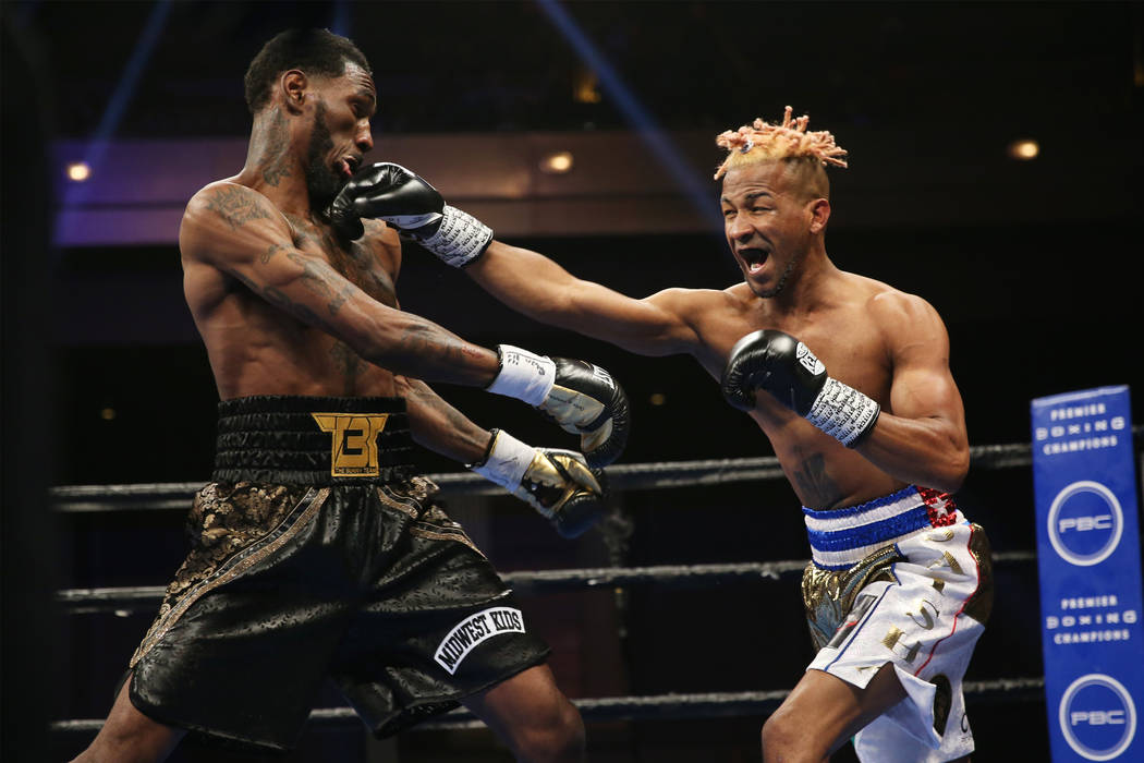 Rances Barthelemy, right, connects a punch against Robert Easter Jr. in the WBA lightweight cha ...