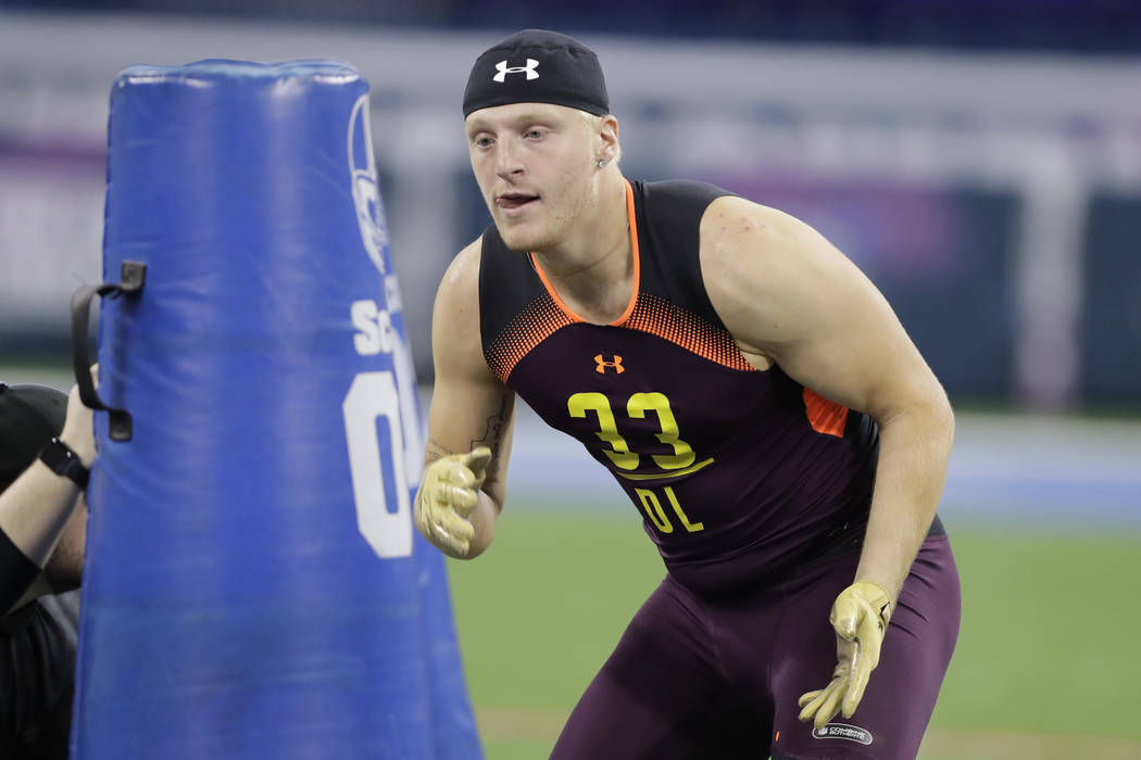 Eastern Michigan defensive lineman Maxx Crosby runs a drill during the NFL football scouting co ...