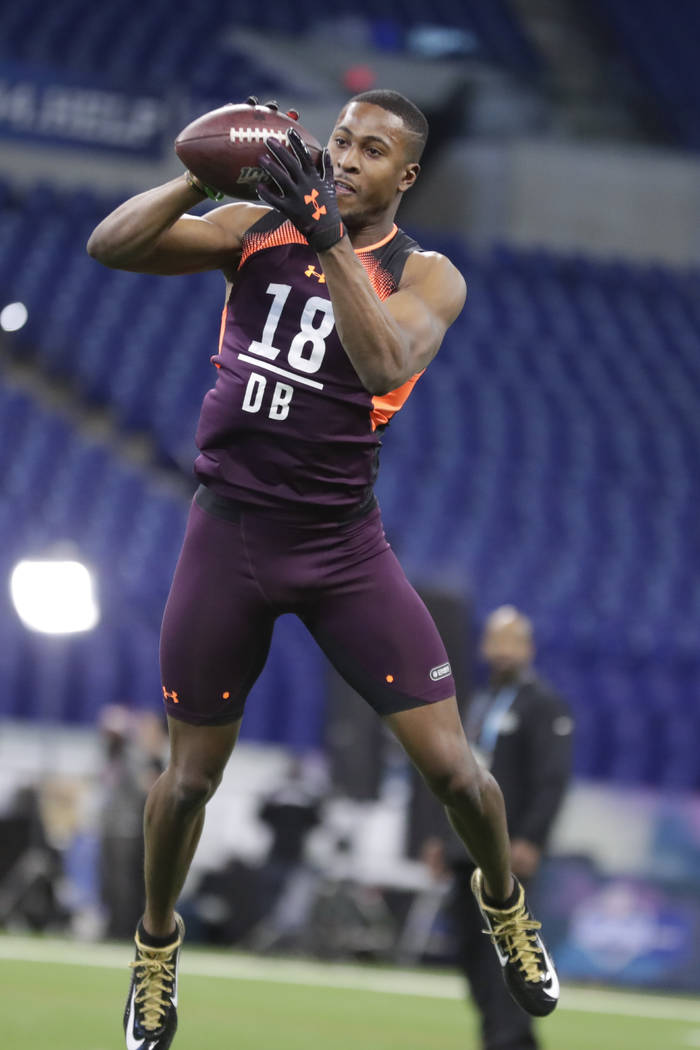 Houston defensive back Isaiah Johnson runs a drill at the NFL football scouting combine in Indi ...