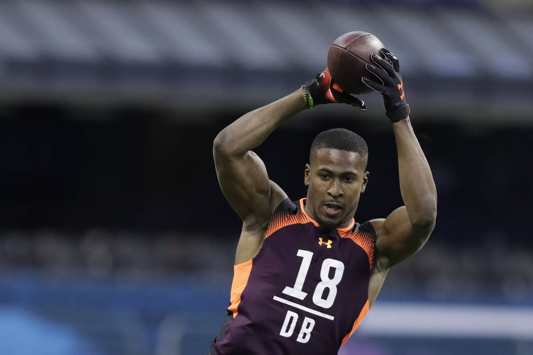 Houston defensive back Isaiah Johnson runs a drill during the NFL football scouting combine, Mo ...
