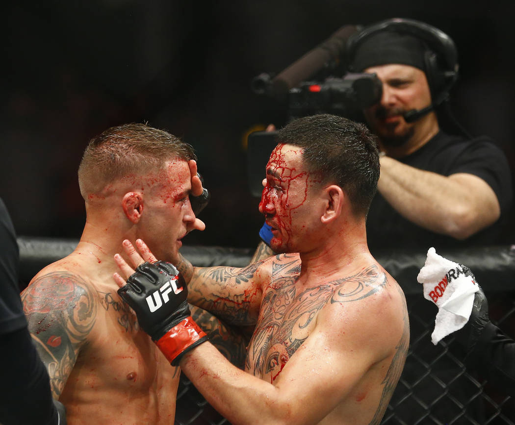 Max Holloway, right, and Dustin Poirier acknowledge one another during an interim lightweight t ...