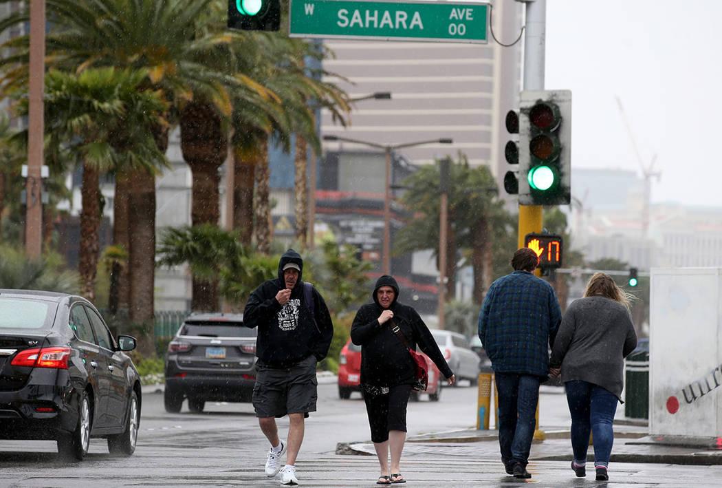 Keith and Kimberly Spahr, of Cincinnati, Ohio, cross Sahara Avenue at Las Vegas Boulevard in La ...