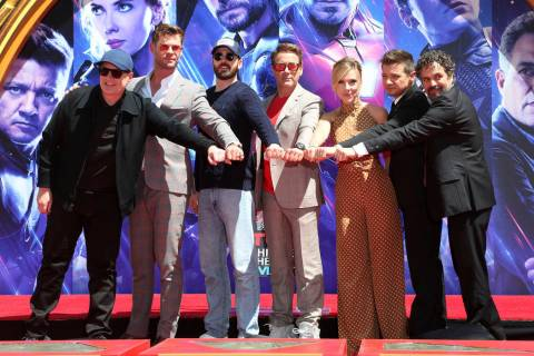 """Marvel Studios President Kevin Feige, from left, poses with members of the cast of """"Avenge ..."""