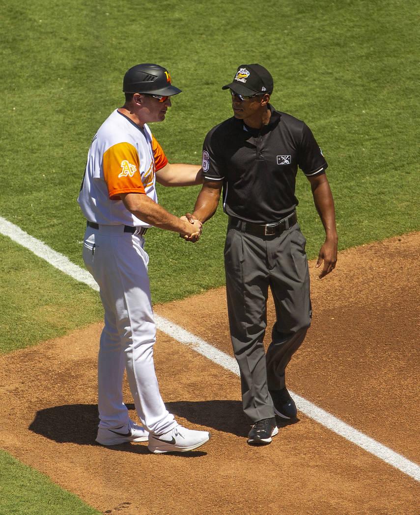Aviators manager Fran Riordan (39) greets one of the umpires as his team faces El Paso at the L ...
