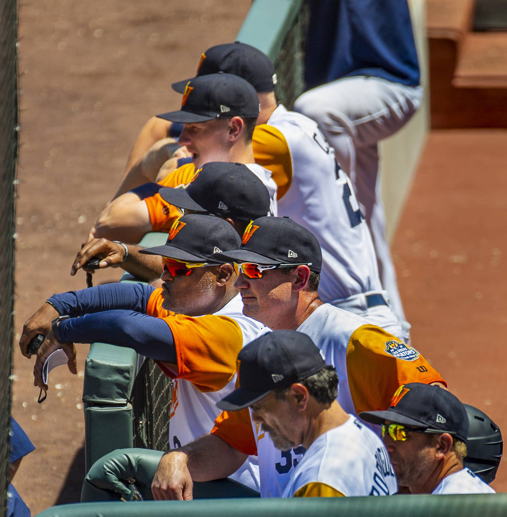 Aviators manager Fran Riordan (39) (center) is joined by others watching their team bat versus ...