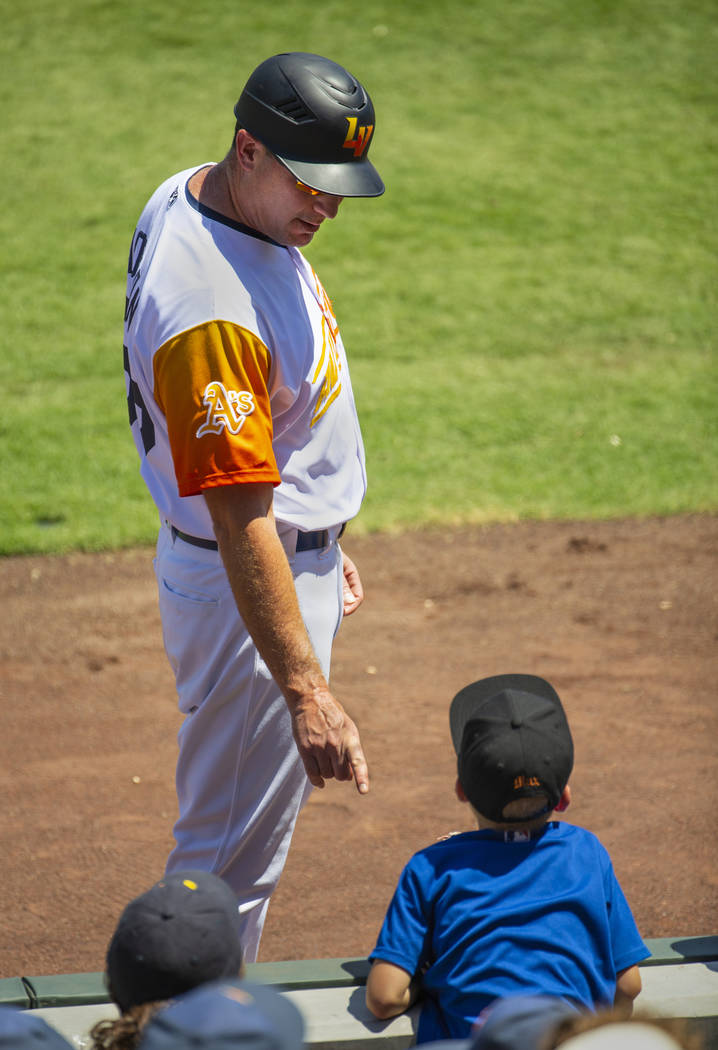 Aviators manager Fran Riordan (39) instructs a young fan to careful and stay off the field afte ...