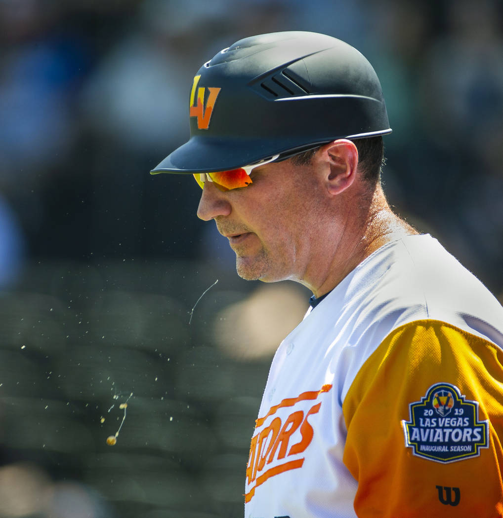 Aviators manager Fran Riordan (39) spits out some juice while guiding his team versus El Paso o ...