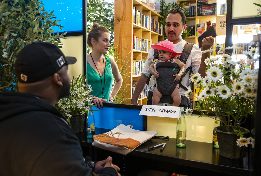 Author Kiese Laymon chats with Kristin Radtke of the Believer Festival beside Ahmed Naji with d ...