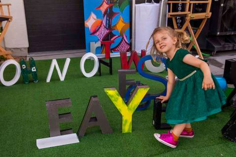 Faye Kerlin Stoelting, 3, spells out her name during the Believer Festival, a three-day literar ...