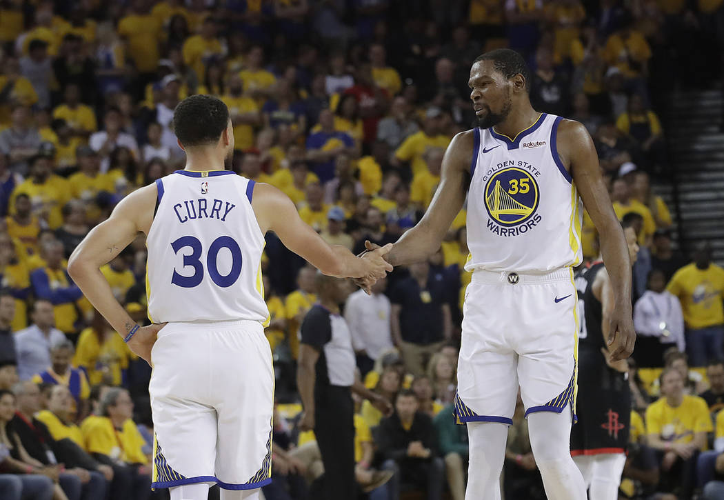 91df88d64166 Golden State Warriors guard Stephen Curry (30) reacts with forward Kevin  Durant (35