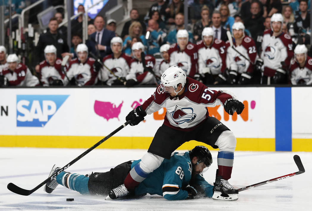 Colorado Avalanche's Gabriel Bourque (57) battles for the puck against San Jose Sharks' Brent B ...