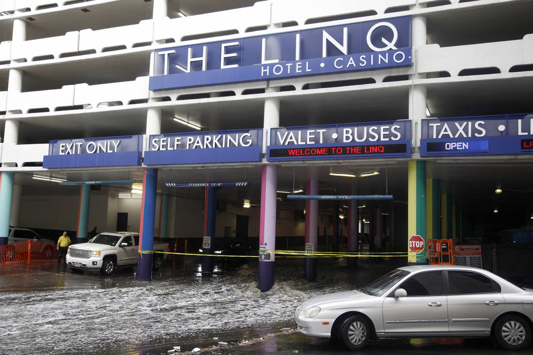 Rain causes flooding at The Linq Hotel and casino parking garage in Las Vegas, Monday, April 29 ...