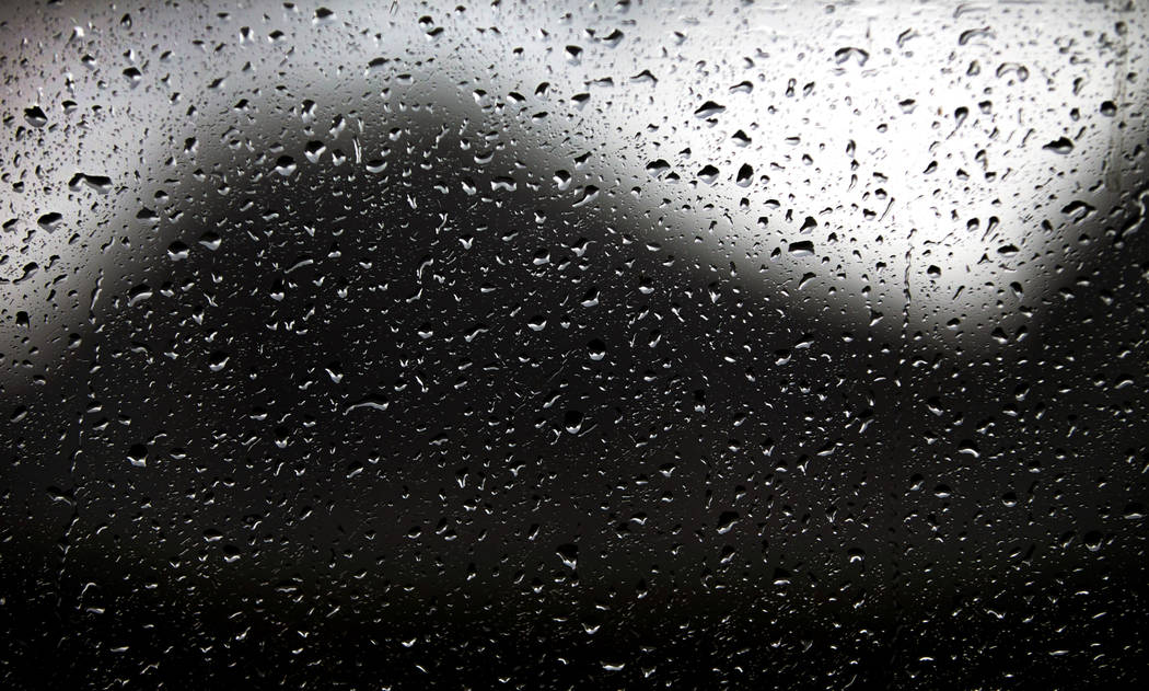 Raindrops gather on a window as a fast-moving storm makes its way through the Red Rock Canyon N ...