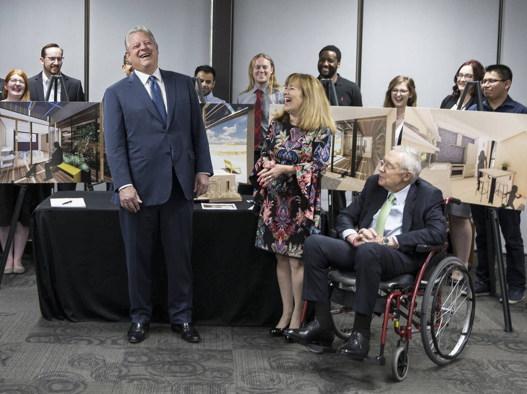 Former U.S. Vice President Al Gore, left, shares a laugh with UNLV President Marta Meana and fo ...