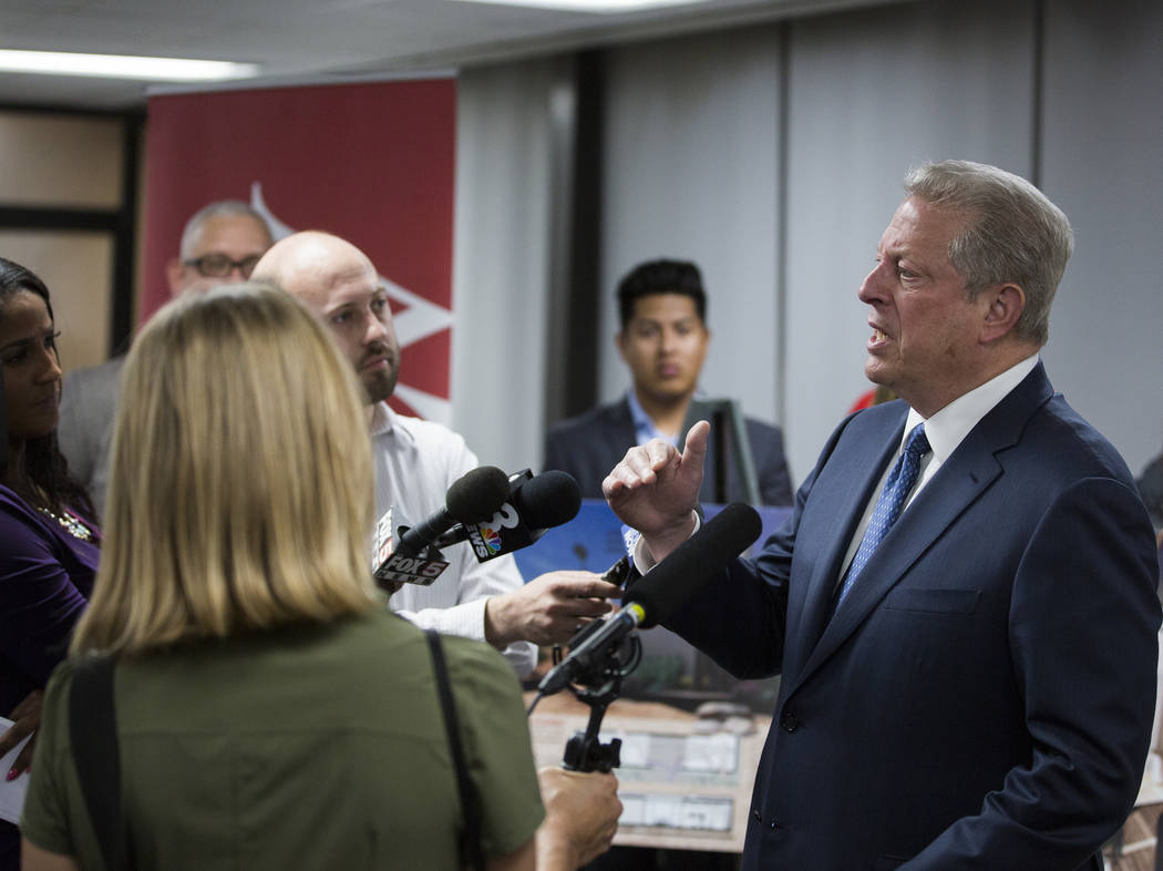 Former U.S. Vice President Al Gore, right, addresses the media after meeting with UNLV's solar ...