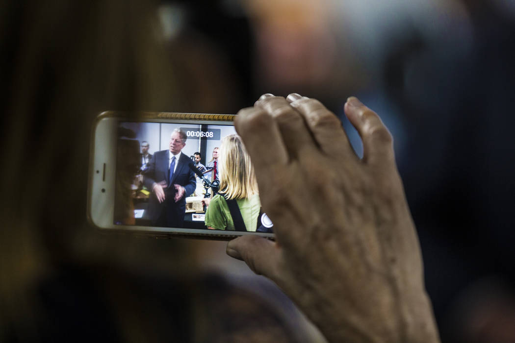 Former U.S. Vice President Al Gore, left, addresses the media after meeting with UNLV's solar d ...