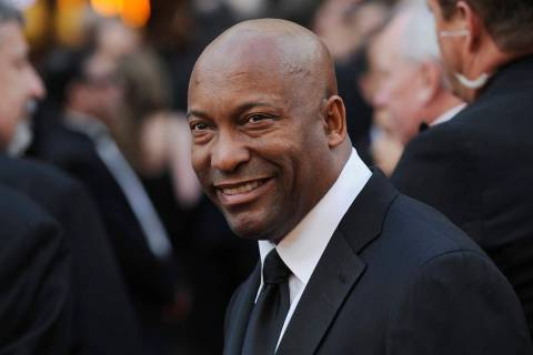 FILE - In this Feb. 24, 2008 file photo, director John Singleton arrives at the 80th Academy Aw ...