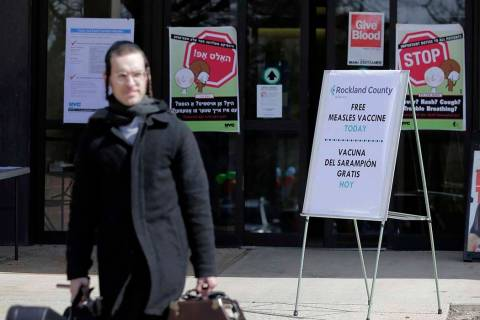 Signs about measles and the measles vaccine are displayed March 27, 2019, at the Rockland Count ...
