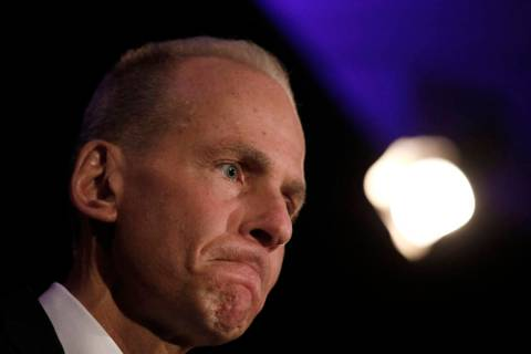 Boeing Chief Executive Dennis Muilenburg speaks during a news conference after the company's an ...