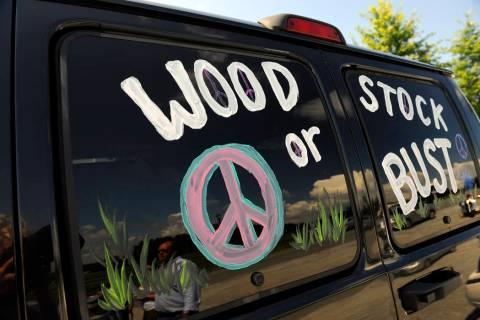 "FILE - This Aug. 14, 2009 file photo shows a van decorated with ""Woodstock or Bust"" a ..."