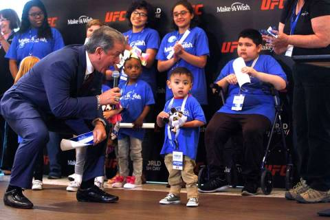 Bruce Buffer, the official announcer for UFC events, tells Jon Ryan Maguiat, 4, on Monday, Apri ...