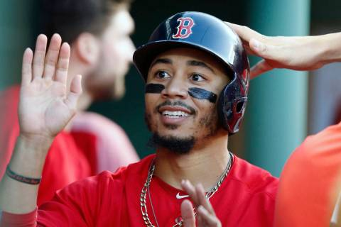 In this Friday, July 13, 2018 file photo,Boston Red Sox's Mookie Betts celebrates after scoring ...