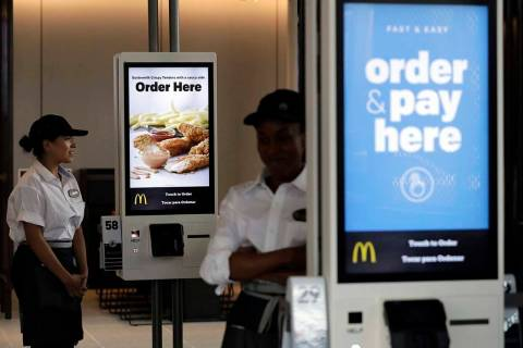 Employees stand Aug. 8, 2018, in McDonald's Chicago flagship restaurant. McDonald's Corp. repor ...