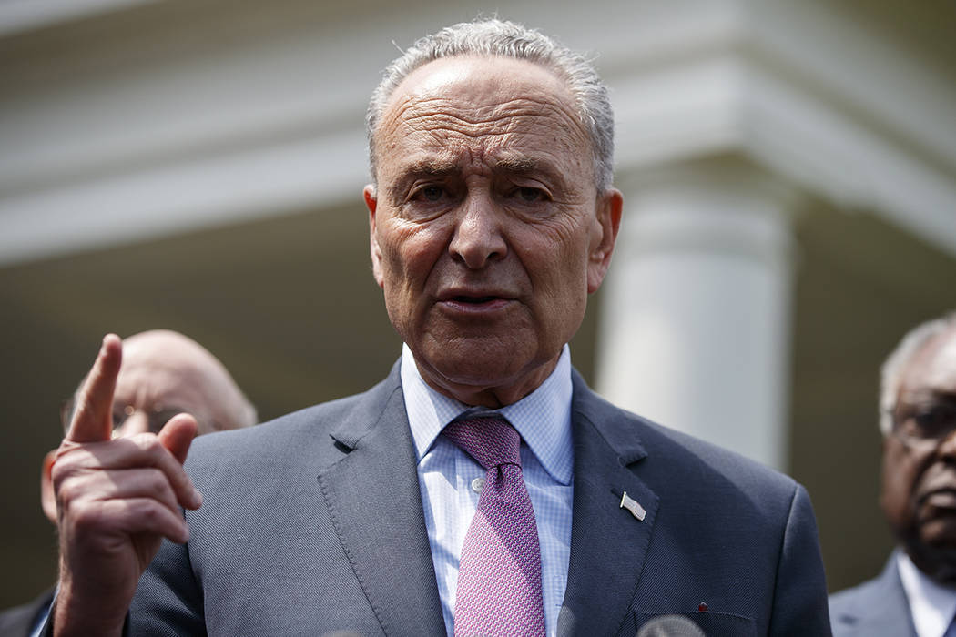 Senate Minority Leader Sen. Chuck Schumer of N.Y., speaks with reporters after meeting with Pre ...