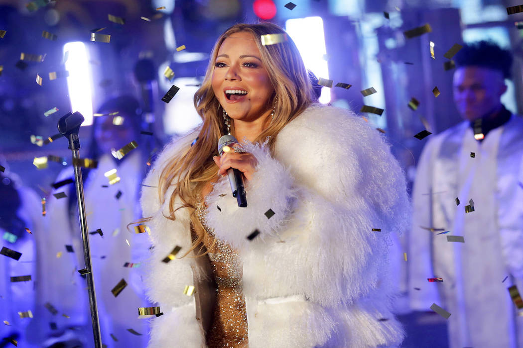 In this Dec. 31, 2017 file photo, Mariah Carey performs at the New Year's Eve celebration in Ti ...