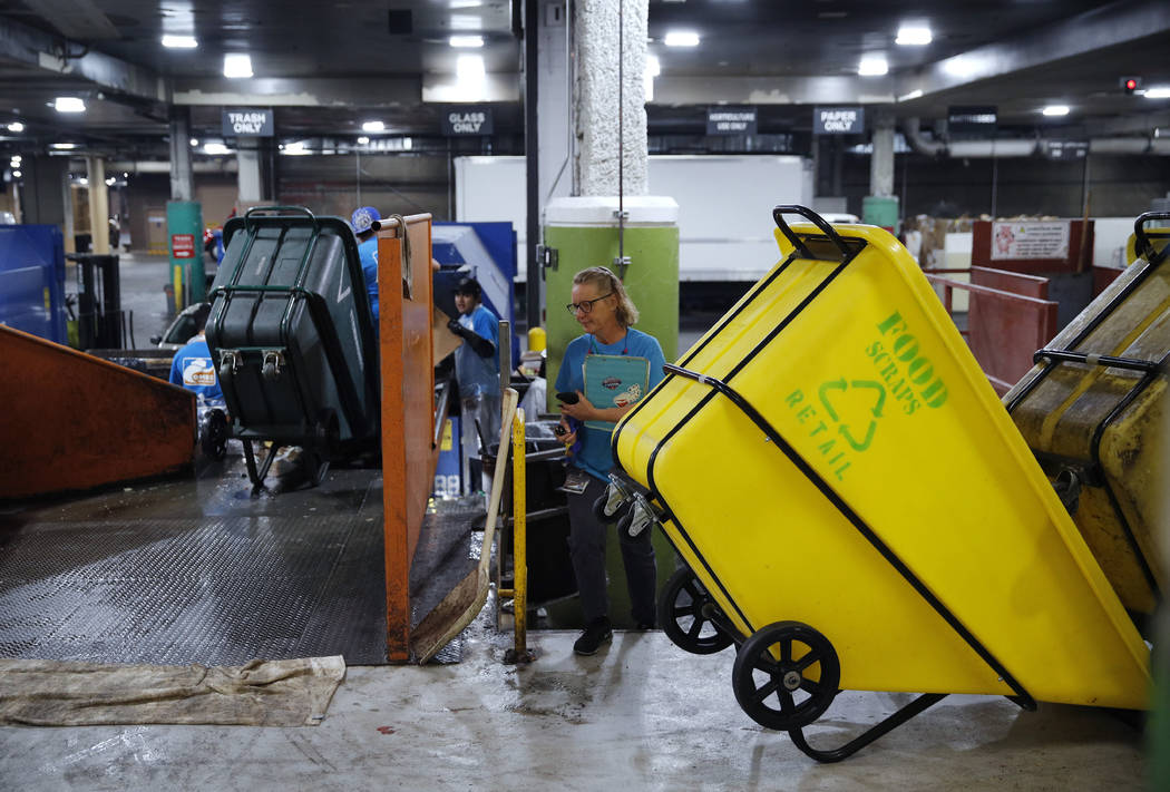 In this March 26, 2019, photo, people work in a recycling area in the back of the house at the ...