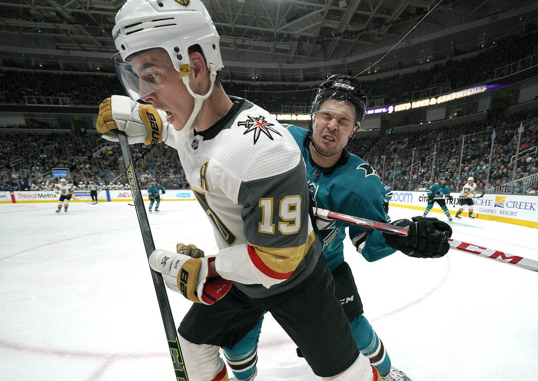 Vegas Golden Knights right wing Reilly Smith (19) is checked into the boards by San Jose Sharks ...