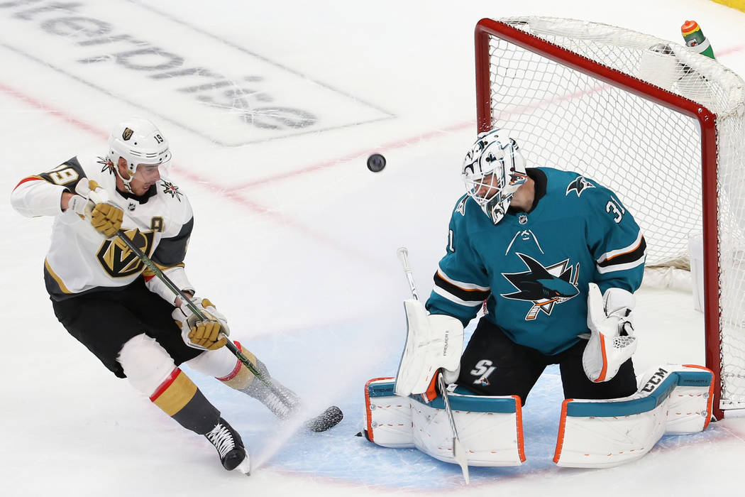 San Jose Sharks goaltender Martin Jones (31) makes a save against Knights right wing Reilly Smi ...