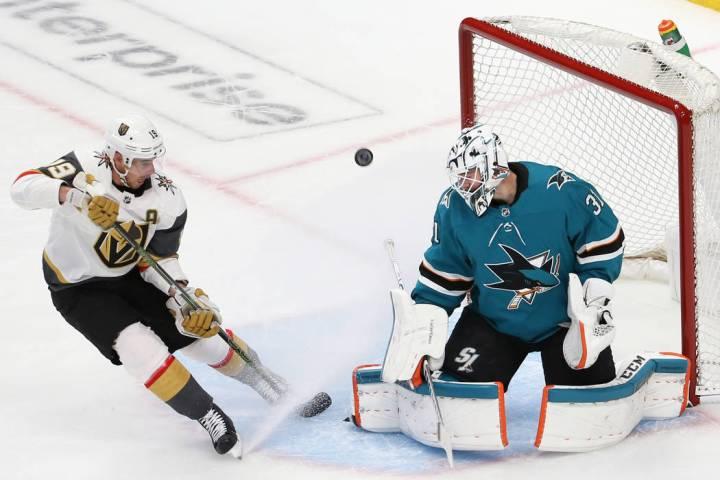 San Jose Sharks goaltender Martin Jones (31) makes a save against Knights right wing Reilly Smi ...